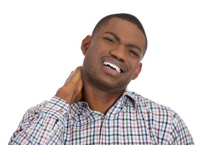 Stressed young man having neck pain